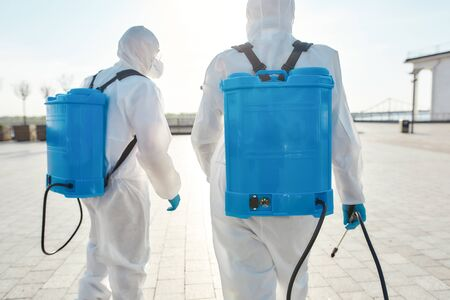 Fast and Reliable. Sanitization and disinfection of the city due to the emergence of the Covid19 virus. Specialized team in protective suits and masks with backpack of pressurized spray disinfectant