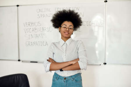 Learn Spanish Online. Portrait of young happy afro american woman, female teacher looking at camera and smiling while teaching Spanish language online from home