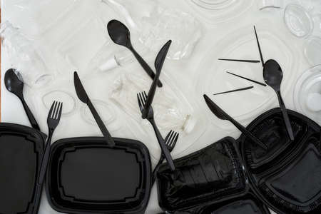 Flatlay composition with used black and white plastic containers over white background 写真素材 - 150645230