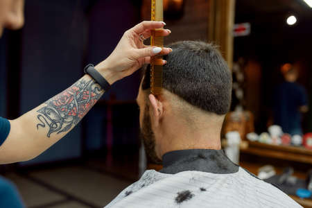 Perfect work. Close up shot of professional barber making trendy haircut for client