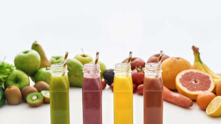 Composition of healthy detox juices and smoothies in bottles with paper straws, Various colorful fruits and vegetables isolated over white background 免版税图像 - 157507523