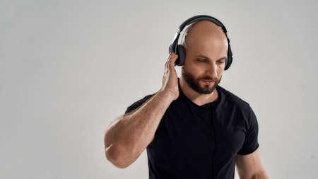 Portrait of handsome caucasian sportsman in headphones
