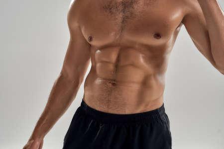 Shirtless muscular torso of young caucasian man
