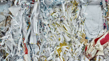 Paper lying in piles on waste disposal station Stock Photo