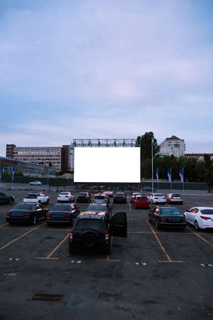 Cars parked in front of drive-in cinema screen