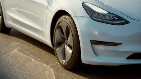 Close up view of front part of white luxury car
