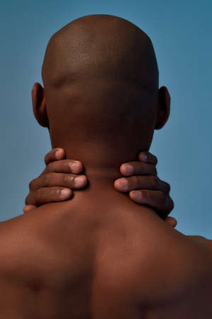 Male person is massaging the aching neck