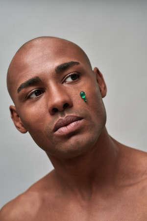 Anti-wrinkles vitamin capsule stuck under person eye
