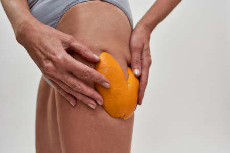 Hip with rind of orange lying on top