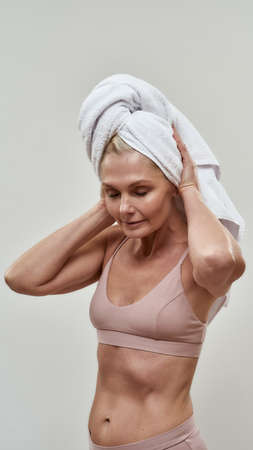 Woman taking off a hair drying towel