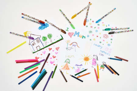 Meaningful gifts for mom from kids. Top view of beautiful colorful child drawings for mothers day on white background