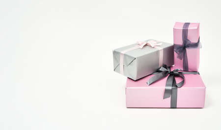 International Womens Day Gifts and Presents. Three colorful wrapped gift boxes with bows against white background
