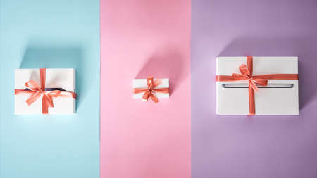 Set of white gift boxes of different sizes with red bows on multicolor background 免版税图像