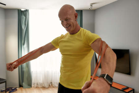 Man in a sports uniform working out at home