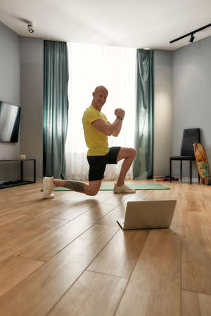 Trainer squatting and doing sports online