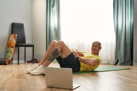 Trainer conducting online work-outing at home
