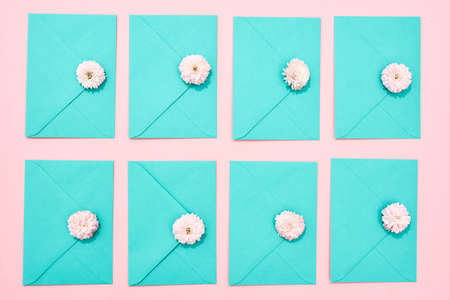 Beautiful envelope with a flower lying on a pink