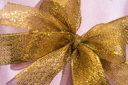 Close up shot of a golden bow on gift box 免版税图像