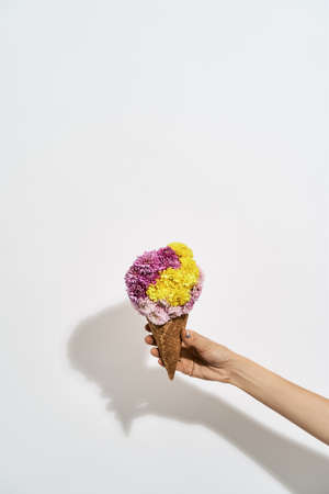 Hand holding a multi-coloring bouquet flowers