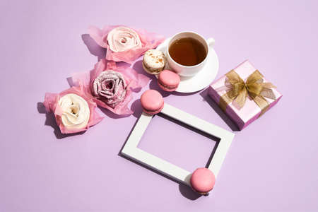 Pink background with tea and roses for March 8