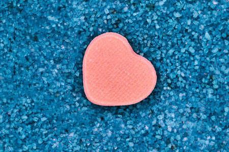 Small heart as a symbol of loving lying on blue 免版税图像