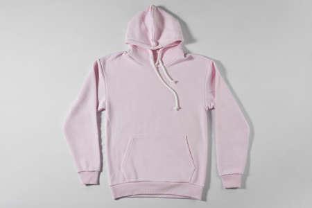 Casual pink hoodie on light background Foto de archivo