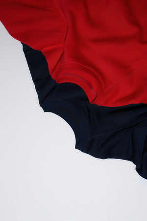 Top view of colorful red and dark blue sport blank sweatshirts isolated on white background