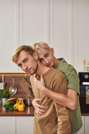 Tender male couple hugging each other Foto de archivo