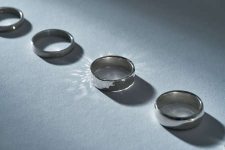 Close up view of sparkling silver engagement rings