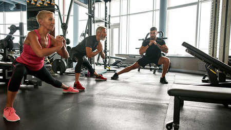 Active family working out in gym together