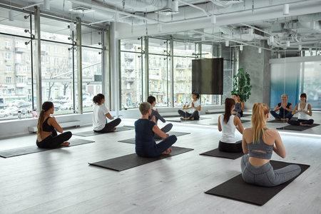 Happy multiethnic women have yoga practice in fitness club Standard-Bild