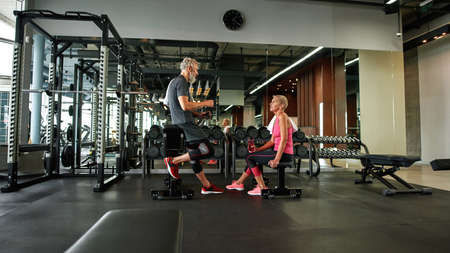 Making new acquaintances after retirement, single man and woman in gym Standard-Bild