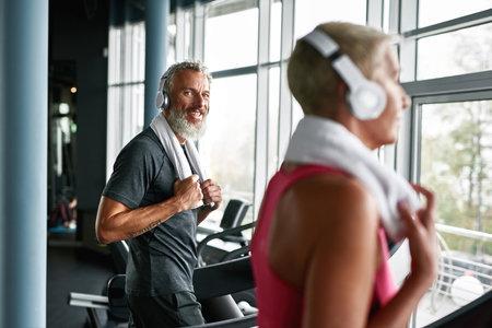 Strong and active pensioner in modern gym Standard-Bild