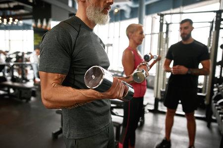 Keeping fit after retirement concept. Elder muscular man portrait