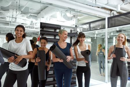Portrait of smiling diverse women have sports training