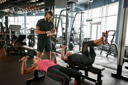 Fit senior couple working out together at gym Standard-Bild