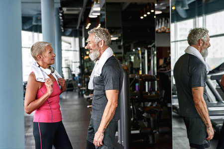 Affectionate mature couple during first meeting in gym