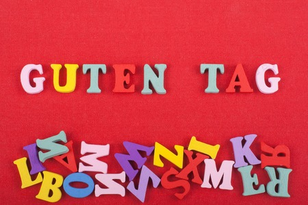 guten tag: GUTEN TAG word on red background composed from colorful abc alphabet block wooden letters, copy space for ad text. Learning english concept.