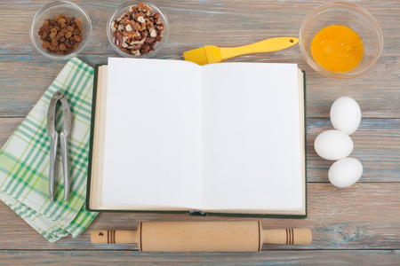 paper pin: Recipe cook blank book on wooden background, spoon, rolling pin, checkered tablecloth