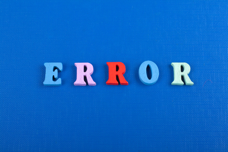 ERROR word on blue background composed from colorful abc alphabet block wooden letters, copy space for ad text. Learning english concept. Stock Photo