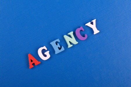AGENCY Word On Blue Background Composed From Colorful Abc Alphabet