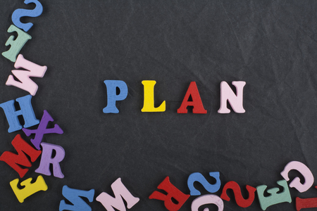 compile: word on black board background composed from colorful abc alphabet block wooden letters, copy space for ad text. Learning english concept Stock Photo