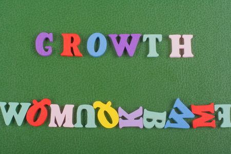 Growth word on green background composed from colorful abc alphabet block wooden letters, copy space for ad text. Learning english concept. Stock Photo