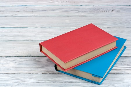 old notebook: Colorful books on white wooden table. Copy space for text. Back to School. Stock Photo