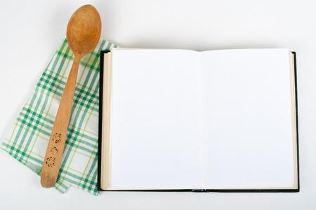 open recipe book on white background. Zdjęcie Seryjne