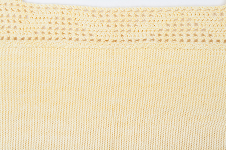 Sweater or scarf fabric texture large knitting. Knitted jersey background with a relief pattern. Wool hand- machine, handmade. Crocheting