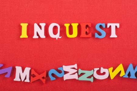 INGUEST word on red background composed from colorful abc alphabet block wooden letters, copy space for ad text. Learning english concept.
