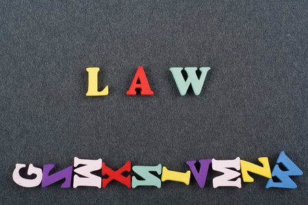 LAW word on black board background composed from colorful abc alphabet block wooden letters, copy space for ad text. Learning english concept.