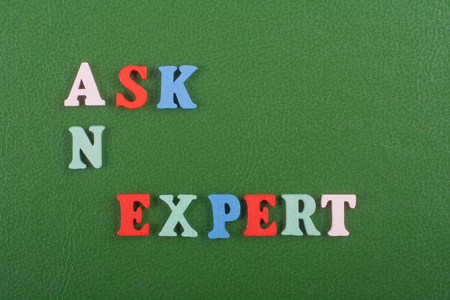 warranty questions: ASK AN EXPERT word on green background composed from colorful abc alphabet block wooden letters, copy space for ad text. Learning english concept.
