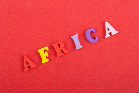 AFRICA word on red background composed from colorful abc alphabet block wooden letters, copy space for ad text. Learning english concept.